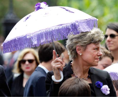 Cokie Roberts, daughter of Lindy Boggs, holds a secondline umbrella during the funeral procession for her mother former Rep. Lindy Boggs (D-La.) at St. Louis Cathedral in New Orleans, Louisiana Thursday, August 1, 2013. Hundreds of colleagues, family and friends  turned out for the funeral of Lindy Boggs, a former Democrat member of Congress, ambassador to the Vatican City, champion of civil rights and mother of commentator Cokie Roberts. Boggs died Saturday at age 97. She took a seat in Congress after a plane carrying her husband. U.S. Rep. and Majority Leader Hale Boggs, vanished while on a flight in Alaska in 1972. Photo/ Susan Poag.