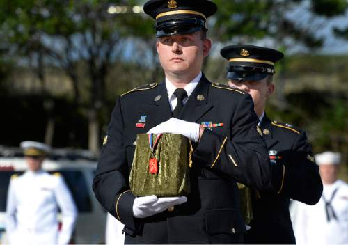 Scott Sommerdorf   |  The Salt Lake Tribune Two members of an Army honor guard carry the remains of two Army veterans who were among the 22 whose remains have never been claimed. They were interred in a service at the state veterans cemetery in Bluffdale on Saturday.