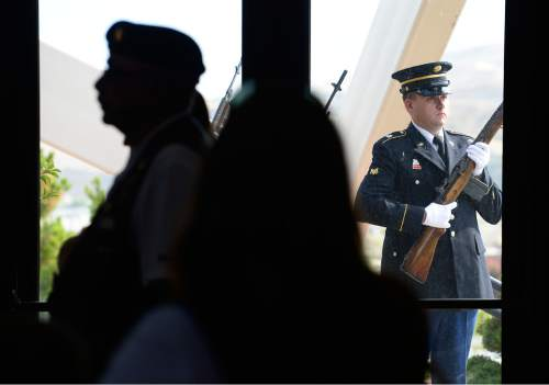 Scott Sommerdorf   |  The Salt Lake Tribune An Army honor guard performs a gun salute during a ceremony honoring 22 veterans whose remains have never been claimed. They were interred in a service at the state veterans cemetery in Bluffdale, Saturday, August 1, 2015.