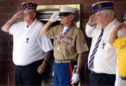 Scott Sommerdorf   |  The Salt Lake Tribune Veterans salute as some of the 22 veterans whose remains have never been claimed were brought in from a hearse prior to a ceremony at the state veterans cemetery in Bluffdale, Saturday, August 1, 2015.