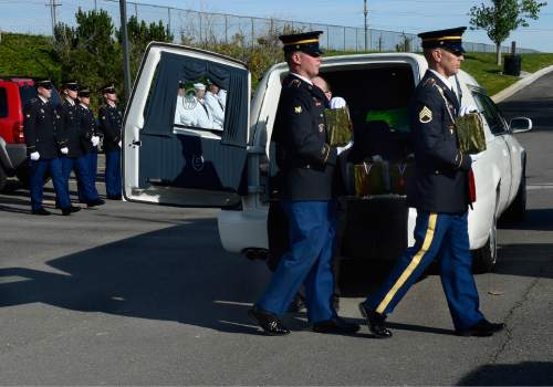 Scott Sommerdorf   |  The Salt Lake Tribune Two members of an Army honor guard carry the remains of two Army veterans who were among the 22 whose remains have never been claimed. They were interred in a service at the state veterans cemetery in Bluffdale, Saturday, August 1, 2015.