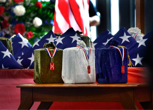 Scott Sommerdorf   |  The Salt Lake Tribune Three containers which hold, from left to right, the remains of an Army, Navy and Air Force veteran whose remains have never been claimed. They sit among the 19 others who were interred in a service at the state veterans cemetery in Bluffdale, Saturday, August 1, 2015.