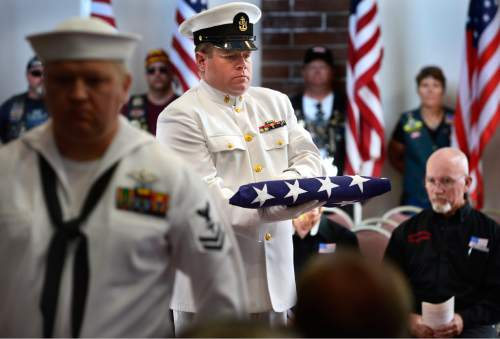 Scott Sommerdorf   |  The Salt Lake Tribune Two members of a Navy honor guard during the flag-folding ceremony for the Navy veterans who were among the 22 whose remains have never been claimed. They were interred in a service at the state veterans cemetery in Bluffdale, Saturday, August 1, 2015.