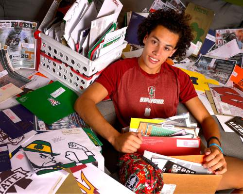 Leah Hogsten  |  The Salt Lake Tribune Brighton High School football star Simi Fehoko is surrounded by the thousands of pieces of correspondence he's received from universities across the country during his recruitment,  July 16, 2015. Fehoko has committed to Stanford.