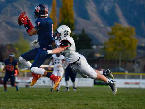 Scott Sommerdorf  |  The Salt Lake Tribune Brighton WR Simi Fehoko catches this pass during second half play. Brighton beat Syracuse 35-14 in a 5A first-round playoff game at Brighton, Friday, October 31, 2014.