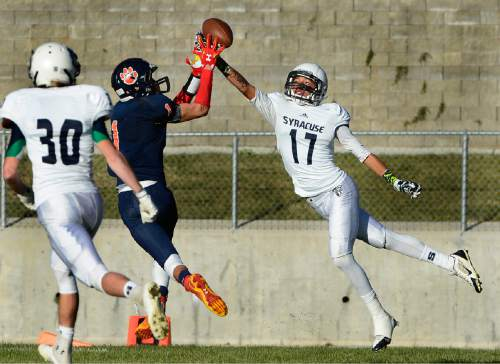Scott Sommerdorf  |  The Salt Lake Tribune Brighton DB Simi Fehoko breaks up a pass intended for Syracuse WR Daunte Atkinson during first half play. Brighton beat Syracuse 35-14 in a 5A first-round playoff game at Brighton, Friday, October 31, 2014.