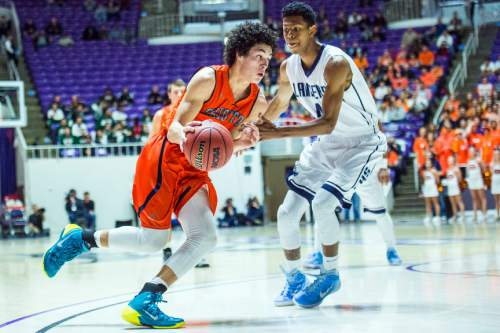Chris Detrick  |  The Salt Lake Tribune Brighton's Simione Fehoko (1) runs past Layton's Kedric Kemp (4) during the 5A championship game at the Dee Events Center Saturday February 28, 2015.  Brighton is winning the game 27-20 at halftime.