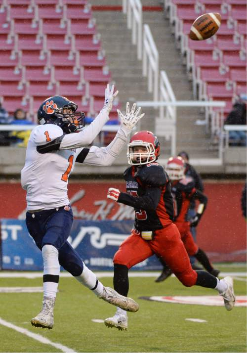 Francisco Kjolseth  |  The Salt Lake Tribune Brighton's Simi Fehoko (1) pulls in a touchdown pass ahead of Jace Miller (15) of American Fork in class 5A state football semifinal at Rice Eccles Stadium on Thursday, Nov. 13, 2014.