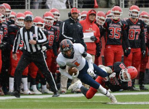 Francisco Kjolseth  |  The Salt Lake Tribune Brighton's Simi Fehoko (1) manages a few extra yards as he is taken down by Jace Miller (15) of American Fork in class 5A state football semifinal at Rice Eccles Stadium on Thursday, Nov. 13, 2014.