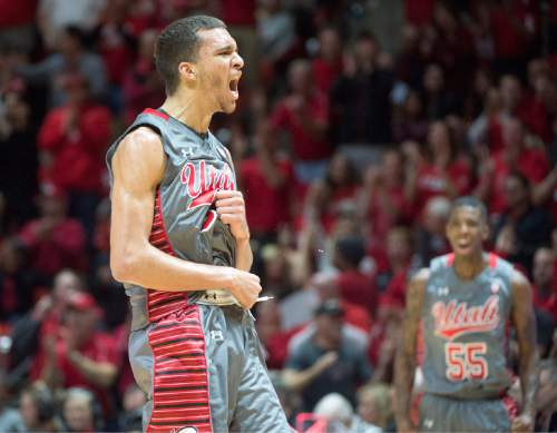 Rick Egan  |  The Salt Lake Tribune  Utah Utes forward Brekkott Chapman (0) reacts after bringing the Utes with in two points of the Wildcats with a 3-point shot, in Pac-12 Basketball action at the Huntsman Center, Saturday, February 28, 2015.  Utah Utes guard Delon Wright (55) cheers in the back ground.