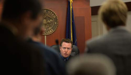 Steve Griffin  |  The Salt Lake Tribune   Judge James Blanch, center, talks to Bill Robert Thompson during his iInitial appearance for first-degree felony murder and other counts in connection with an alleged May 8 drunken driving episode in which he killed 43-year-old Susan Madsen and critically injured her daughter, Tessa. Thompson appeared at the Matheson Courthouse in Salt Lake City, Utah Thursday, May 22, 2014.