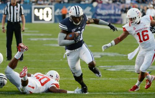 Steve Griffin  |  The Salt Lake Tribune   BYU Cougars running back Jamaal Williams (21) splits the Houston defense on his way to a touchdown during game between BYU and Houston and LaVell Edwards Stadium in Provo, Thursday, September 11, 2014.