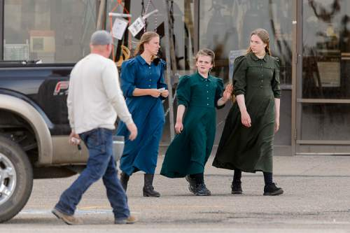 Trent Nelson  |  The Salt Lake Tribune Three young women in fundamentalist prairie dresses in the parking lot of a retail store in Rawlins, Wyoming, Tuesday June 30, 2015.