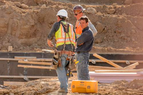 Trent Nelson  |  The Salt Lake Tribune Workers from Phaze Concrete on the construction site of the new Rawlins High School in Rawlins, Wyoming, Tuesday June 30, 2015.