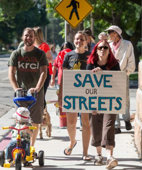 Rick Egan  |  The Salt Lake Tribune South Salt Lake residents march to State Street on Saturday to demonstrate their opposition to the noise, inconvenience and increased traffic caused by the closure of Burton and Truman Avenues.
