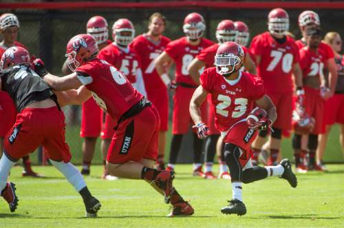 University of Utah running back Devontae Booker follows his blockers as he races up field during NCAA football camp, Thursday, Aug. 6, 2015 at the University of Utah  in Salt Lake City. (Steve Griffin/The Salt Lake Tribune via AP) DESERET NEWS OUT; LOCAL TELEVISION OUT; MAGS OUT; MANDATORY CREDIT