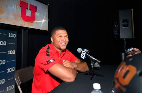 Utah running back Devontae Booker speaks to reporters during NCAA college Pac-12 Football Media Days, Friday, July 31, 2015, in Burbank, Calif. (AP Photo/Mark J. Terrill)