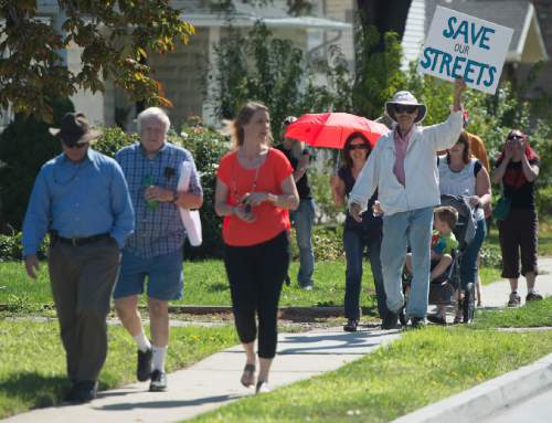 Rick Egan  |  The Salt Lake Tribune  South Salt Lake residents march to State Street to demonstrate their opposition to the noise, inconvenience and increased traffic caused by the closure of Burton and Truman Avenues, Saturday, Aug. 8, 2015.