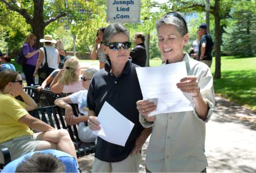 Scott Sommerdorf   |  The Salt Lake Tribune Twin sisters Ellen, left, and Jane Jensen read over their resignation letters prior to filling them out at a mass resignation and rally, Saturday, July 25, 2015.