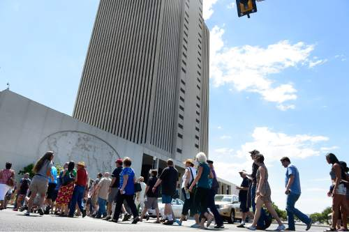Scott Sommerdorf   |  The Salt Lake Tribune About 200 people marched across North Temple Street on their way to the church office building to deliver their resignation letters, Saturday, July 25, 2015.