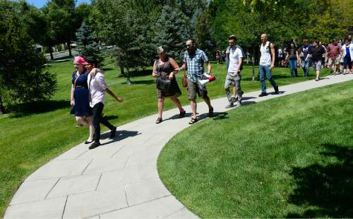 Scott Sommerdorf   |  The Salt Lake Tribune The beginning of a group of about 200 people began their march from City Creek Park on their way to the church office building to deliver their resignation letters, Saturday, July 25, 2015.