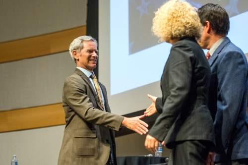 Chris Detrick  |  The Salt Lake Tribune Salt Lake City Mayor Ralph Becker shakes hands with City Council Chairman Luke Garrott and former state legislator Jackie Biskupski after a Salt Lake City Mayoral Debate at Salt Lake City's Main Library Thursday July 16, 2015.