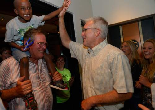 Leah Hogsten  |  The Salt Lake Tribune Salt Lake County Sheriff Jim Winder greets Jackie Biskupski's son Archie, 5, with a hand slap as they celebrate Biskupski's primary win, August 11, 2015 at Stoneground Kitchen. Former state legislator Jackie Biskupski and Salt Lake City Mayor Ralph Becker won Tuesday's primary race for the mayor's seat and will face off in the Nov. 3 general election.