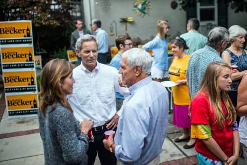Chris Detrick  |  Tribune file photo Salt Lake City Mayor Ralph Becker talks to Kim Wirthlin and Dave Jones at his home in Salt Lake City Tuesday August 11, 2015.