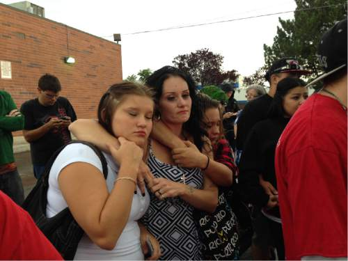 Erin Alberty  |  The Salt Lake Tribune   Mourners comfort each other as they honor the one-year anniversary of the death of Dillon Taylor. Taylor, 20, was shot to death by a Salt Lake City police officer outside a 7-Eleven near 2100 S. State St.
