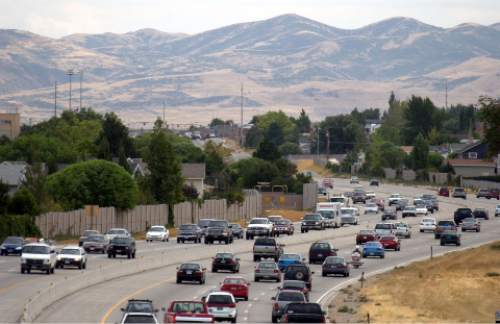 Trent Nelson  |  Tribune file photo Traffic moves south along the Bangerter Highway in 2003.