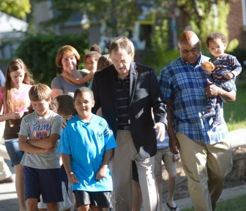Al Hartmann  |  The Salt Lake Tribune                                                                         Utah Governor Gary Herbert takes a practice walk with Highland Park Elementary School parents and students in Salt Lake City Thursday August 13 to get ready for the upcoming school year.  He wants them to ditch carpools and set up walking school bus groups using UDOTís Walking School Bus App.  The app allows parents to coordinate walking groups to and from school and notifies them when  children have arrived safely.