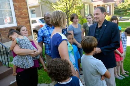Al Hartmann  |  The Salt Lake Tribune                                                                                                                    Utah Governor Gary Herbert gathers with Highland Park Elementary School parents and students in Salt Lake City Thursday August 13 to help them ditch carpools and set up walking school bus groups using UDOT's Walking School Bus App.  The governor, parents and children took a practice walk together to Highland Park Elementary School to get ready for the upcoming school year.