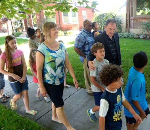 Al Hartmann  |  The Salt Lake Tribune                                                                                                                    Utah Governor Gary Herbert takes a practice walk with Highland Park Elementary School parents and students in Salt Lake City Thursday August 13 to get ready for the upcoming school year.  He wants them to ditch carpools and set up walking school bus groups using UDOT's Walking School Bus App.  The app allows parents to coordinate walking groups to and from school and notifies them when  children have arrived safely.