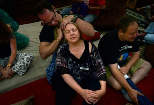 "Scott Sommerdorf   |  The Salt Lake Tribune Pam Bradford and Joe Tuttle during a ""cuddle party"" - a regular meet-up that happens in Utah, where strangers get together and cuddle in a nonsexual way, Friday, July, 31, 2015."