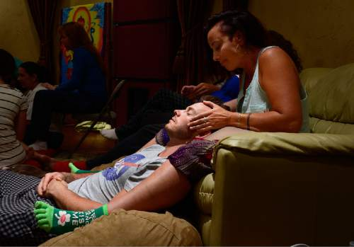 "Scott Sommerdorf   |  The Salt Lake Tribune Hannah Laine massages Jeff Cardon's head during ""cuddle party"" - a regular meet-up that happens in Utah, where strangers get together and cuddle in a nonsexual way, Friday, July, 31, 2015."