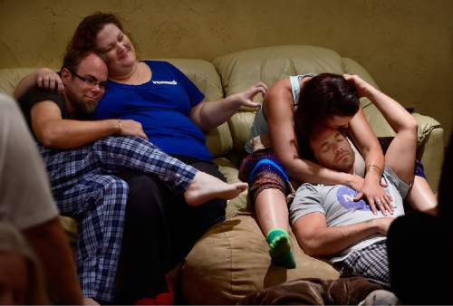 "Scott Sommerdorf   |  The Salt Lake Tribune Joe Tuttle and Melissa Jones cuddle, left, and Hannah Laine and Jeff Cardon, right, relax during a ""cuddle party"" last month -- a regular meet-up that happens in Utah, where strangers get together and cuddle in a nonsexual way."