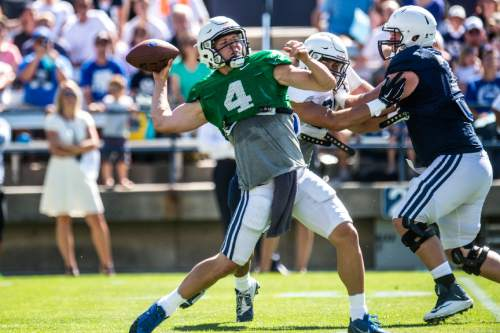 Chris Detrick  |  The Salt Lake Tribune Brigham Young Cougars quarterback Taysom Hill (4) passes the ball during a scrimmage at LaVell Edwards Stadium Saturday August 15, 2015.