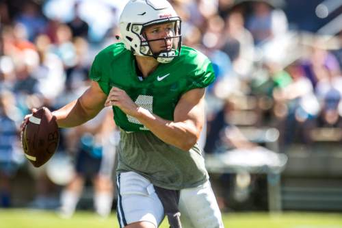 Chris Detrick  |  The Salt Lake Tribune Brigham Young Cougars quarterback Taysom Hill (4) looks to pass during a scrimmage at LaVell Edwards Stadium Saturday August 15, 2015.