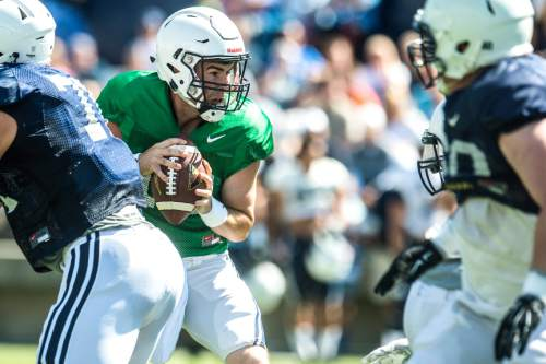 Chris Detrick  |  The Salt Lake Tribune Brigham Young Cougars quarterback Tanner Mangum (12) during a scrimmage at LaVell Edwards Stadium Saturday August 15, 2015.
