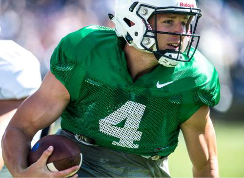 Chris Detrick  |  The Salt Lake Tribune Brigham Young Cougars quarterback Taysom Hill (4) runs the ball during a scrimmage at LaVell Edwards Stadium Saturday August 15, 2015.