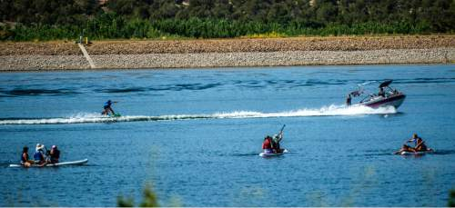 Chris Detrick     The Salt Lake Tribune Boaters, tubers and paddle boarders enjoy Wide Hollow Reservoir in Escalante Thursday July 30, 2015.