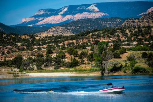 Chris Detrick     The Salt Lake Tribune Boaters and tubers enjoy Wide Hollow Reservoir in Escalante Thursday July 30, 2015.