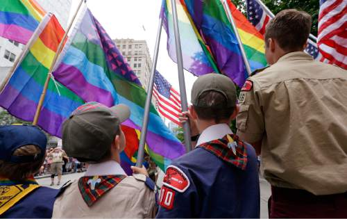 Elaine Thompson  |  AP file photo Cub Scouts and Boy Scouts prepare to lead marchers while waving rainbow-colored flags in June at the 41st annual Pride Parade in Seattle, two days after the U.S. Supreme Court legalized gay marriage nationwide. On Monday, the Texas-based Boy Scouts of America ended its blanket ban on gay adult leaders but will allow church-sponsored Scout units to maintain the exclusion for religious reasons.