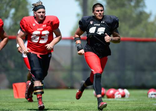 Scott Sommerdorf   |  The Salt Lake Tribune Utah DE Kylie Fitts, right, takes part in wind sprints at the end of Utah football practice, Saturday, August 15, 2015. At left is OL Griffin Kemp.