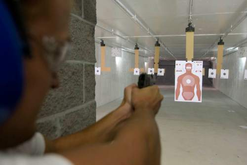 Tribune File Photo A shooter at Doug's Shoot N Sport's gun range takes aim at a human shaped target.