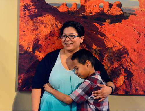 Trent Nelson  |  The Salt Lake Tribune 10-year-old Eric Guadarrama embraces his mother, Grisel Guadarrama, after she spoke at a press conference addressing Utah's lack of Medicaid expansion held at the State Capitol Building in Salt Lake City, Tuesday August 18, 2015.