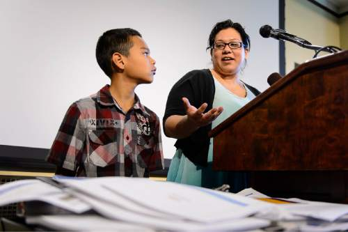 Trent Nelson  |  The Salt Lake Tribune 10-year-old Eric Guadarrama looks on as his mother, Grisel Guadarrama, speaks at a press conference addressing Utah's lack of Medicaid expansion held at the State Capitol Building in Salt Lake City, Tuesday August 18, 2015.