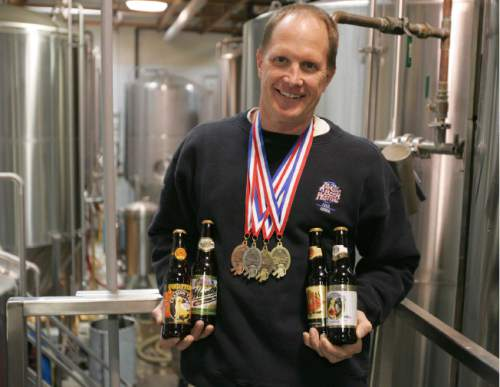 Trent Nelson  |  The Salt Lake Tribune   Wasatch Brewery brewmaster Dan Burick with the four medals (two golds, one silver and one bronze) his brews won at the 2004 Great American Beer Festival. Provo Girl Pilsner and India Pale Ale won gold medals, Chasing Tail Ale won silver and Wasatch Hefe Weisen won bronze.