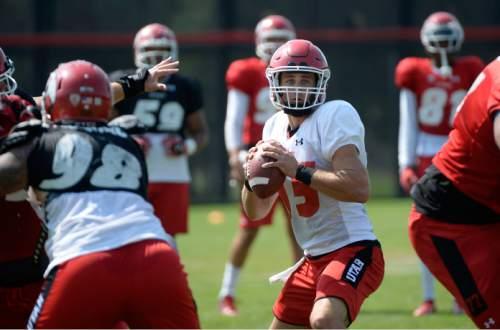 Al Hartmann     The Salt Lake Tribune Quarterback Chase Hansen looks for a receiver down field during practice Monday August 17.