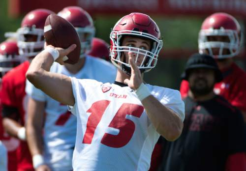 Steve Griffin     The Salt Lake Tribune  University of Utah quarterback Chase Hansen throws a pass during first day of fall football camp at the University of Utah baseball field in Salt Lake City, Thursday, August 6, 2015.  l